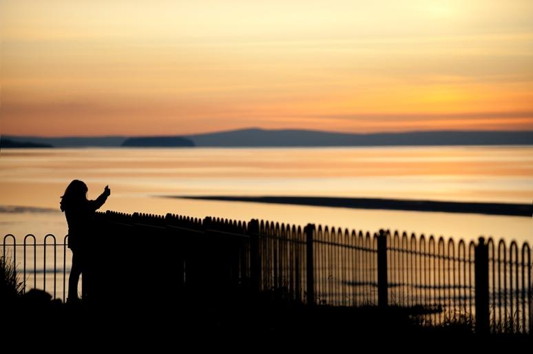 Woman-taking-shot-at-sunset
