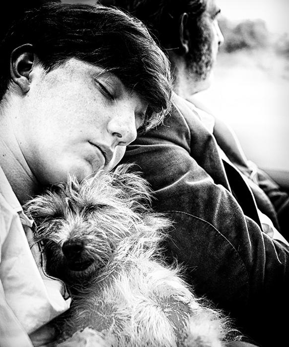 Sleeping-child-and-dog-on-train